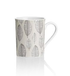 This pretty leaf print mug adds a delicate sense of femininity to afternoon tea or coffee mornings. Made from porcelain, it's microwave and dishwasher safe for added convenience and versatility. We love the idea that it's bringing a little of the outdoors into your home  and taking inspiration from the natural world - a key trend for Autumn Winter 2012! £5 from Marks and Spencer.