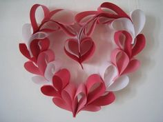 If you can make a paper heart out of a strip of paper then you can make this heart wreath. I know I saw this idea some where...probably Martha Stewart.