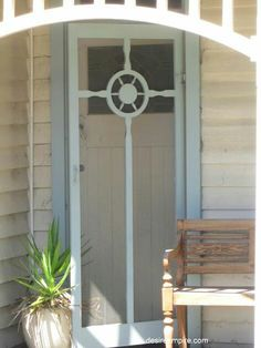 Updated Coastal Cottage Entrance with a Vintage Screen Door !