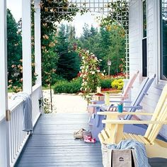 Adirondack chairs in soft sherbet tones pretty up a porch that is both old-fashioned and fresh at the same time. Cottage Porch, Home Porch, Cottage Bedrooms, Porch Garden, Cozy Cottage, Interior Pastel, Outdoor Rooms, Outdoor Decor, Outdoor Living