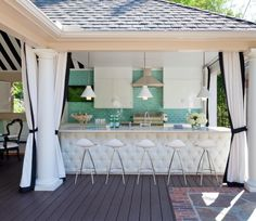 Tobi Fairley - Gorgeous outdoor kitchen features kitchen island with sink accented with gooseneck faucet filling cabana accented with black and white outdoor curtains. Outdoor Curtains, Outdoor Rooms, Outdoor Dining, Outdoor Decor, Outdoor Kitchens, Outdoor Bars, Outdoor Projects, Outdoor Life, Indoor Outdoor