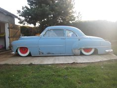 Baby blue 49 Chevy Sport Coupe on custom lowered suspension. Side view