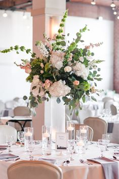 Gorgeous white and pink flowers make a perfect centerpiece! | Charlotte wedding, Charlotte wedding vendors, chic, industrial, NC wedding, NC wedding vendors | Florals @cluxrentals Photo @KEPhotoCLT Planner @somethingperf DJ @splitsecond Catering @bicaterers Beauty @calistott Attire @newyorkbride