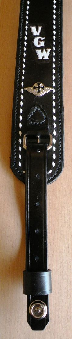 Ric's Leather Guitar Strap with Buckstitching and Conchos
