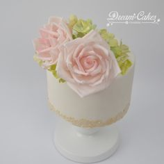 A simple little wedding cake with sugar roses and hydrangeas
