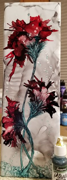 Flowers in alcohol ink on long 12x4 ceramic tile by TINA. Trying pinata ink for the first time.