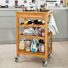Amazon.com: SoBuy Bamboo Kitchen Trolley Cart with Black Tempered Glass Worktop, L58xW40xH90cm, Nature Color, FKW16-G-N + Free Chopping Block: Home & Kitchen - $90.00. Use as coffee and alcohol bar. That way it can be wheeled into the living room when guests come. Espresso machine, coffee maker, labeled coffee jars, and flavored syrups on top two shelves; alcohol on bottom two shelves. Bar tools and extra spoons in drawer.