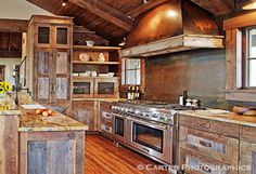 rustic glamour created using recycled timber throughout this kitchen