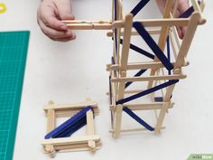How to Build a Popsicle Stick Tower. Popsicle stick towers are a common engineering project to be assigned in school.Your assignment may have various criteria for height, weight, and number of popsicles, but this guide will give you a. Craft Stick Projects, Diy Wood Projects, Craft Stick Crafts, Crafts For Kids, Popsicle Stick Crafts, Popsicle Sticks, Popsicle House, Flower Tower, Making A Model