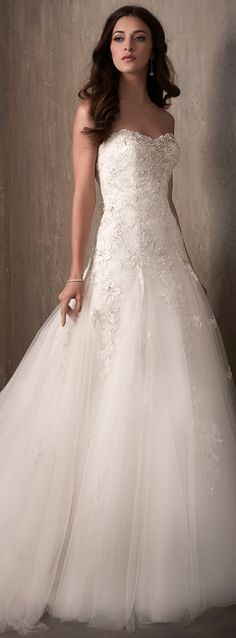 A-line princess wedding dress by Adrianna Papell with tulle skirt and sweetheart neckline