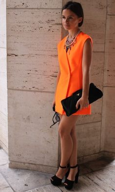 Orange dress- Bright color for the spring/summer season, can possibly work with a sweater and tights for fall/winter. On the short side, but still nice!