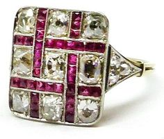 Antique gold and silver mounted lattice work French-cut ruby and diamond square cluster ring.