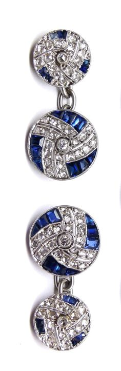 Art Deco diamond and sapphire gentlemans dress set comprising a pair of cufflinks and three buttons, French c.1925 , the round panels millegrain set with rose cut diamonds and calibre sapphires in a triple spiral swirl design, the cufflinks with smaller and larger panels and with chain connections, mounted in platinum