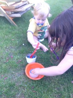 I put some big daisy heads in a small Pyrex dish in water and froze them, then I found the blue glittery salt again and off they went with spoons and later the water sprayer! They loved this! Rally loved it!!