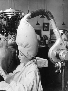 Vintage hair dryer (what's that scary contraption to her left? Perm setting device?) Re-Pinner-yes, I had to learn to do a perm on one of these before I could get my license, even though they were already old and not used.