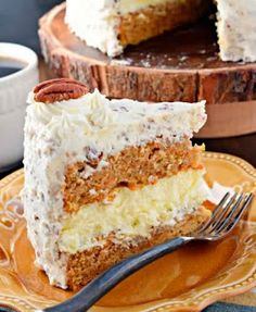 Carrot Cake Cheesecake Cake This Carrot Cake Cheesecake Cake recipe is a showstopper! Layers of homemade carrot cake, a cheesecake center and it's all topped with a delicious cream cheese frosting! Ingredients: For the carrot cake layers: 2 Carrot Cake Cheesecake, Cheesecake Recipes, Butter Pecan Cheesecake Recipe, Birthday Cheesecake, Homemade Cheesecake, Chocolate Cheesecake, Just Desserts, Delicious Desserts, Cake Recipes