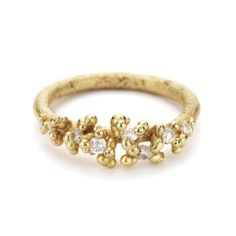 An alternative engagement ring featuring white diamonds set amongst granules of 18ct yellow gold