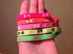 Rainbow colored under armour headbands