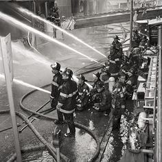 FDNY Firefighters responding to a 4-alarm fire at 7 Elliot Place, the Bronx, on July 25, 1968