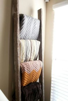 Organize blankets on old ladder.
