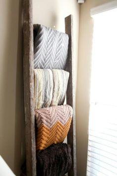 Organize blankets on old ladder.