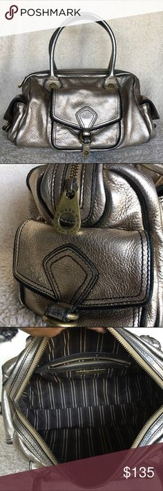 """Marc by Marc Jacobs metallic calfskin satchel 100% Authentic Marc by Marc Jacobs metallic calfskin satchel in gold with bronze hardware. There are 3 exterior pockets with magnetic closures. This is in fair used condition with normal wear on the corners and handles. No tears or loose stitching. No dust bag. Size: 14""""L x 9""""H x 5""""D Marc by Marc Jacobs Bags Satchels"""
