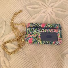 sale Lilly Pulitzer cross body ID phone purse Used once! Perfect condition! Carries coins, cards and your phone! It fit my iPhone 4s and my iPhone 6 with a case! Lilly Pulitzer Bags Mini Bags