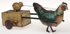 GERMAN CHICK AND CHICKEN WIND-UP TIN TOY - by Jeffrey S. Evans & Associates