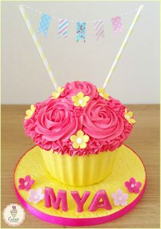 Cutsie Cupcakes - A Giant Yellow  Pink Cupcake with Bunting for a 'Cake Smash' Photo Session, something very popular for little girls and boys First Birthday