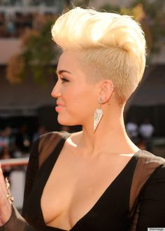 Miley Cyrus rockin the mohawk look with a pompadour.