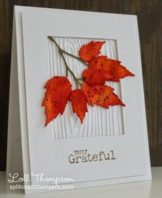 handmade card from Stamping with Loll ... white with a brilliant splash of mottled reds and oranges .... Autumn leaves ... like the woodgrain embossing folder texture inside the frame ... great card!