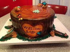 Rustic baby shower tree stump with butterflies. Loven Cakes 573-694-8853. Versailles, MO