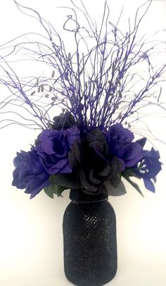 Black Rose Flower Arrangement  My original design. It is a hand crafted bouquet arranged in a glass Mason jar and wrapped in a black cloth. This