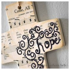 "Easy, pretty cross craft. SO pretty!  i think i'd have to do ""the old ship of zion"" :)  tea stain the copy of the hymnal page."