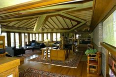 Frank Lloyd Wright's Coonley House, living room showing off a flamboyant zest for materials and planes - I guess you'd have to SEE it to truly appreciate it?