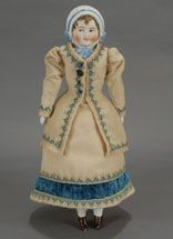 If you are a collector of dolls with molded hats, or special features, look no further as this rare example could have your name on it. Deta...