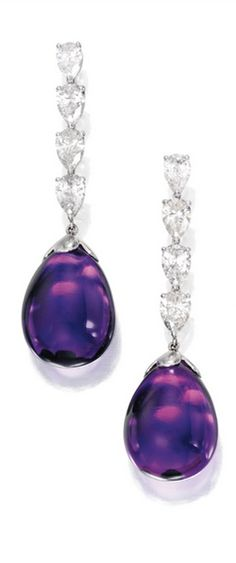Pair of Platinum, Amethyst and Diamond Earrings Anchored by two amethyst drops weighing approximately 64.00 carats, suspended by eight pear-shaped diamonds weighing approximately 5.50 carats.