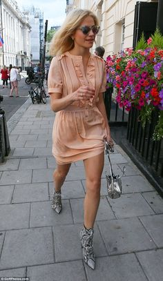 These boots were made for walking: Pixie showed off her long legs in the pastel number, which was completed with a pair of snakeskin print shoes