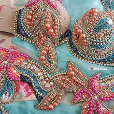 Pink and blue belly dance bedlah with pearl swirls and tropical flowers.