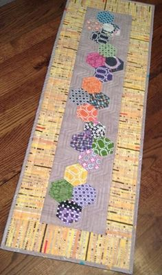 Skinny Table Runner using a charm pack and paper hexagons (English Paper Piecing) by janice