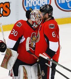 Ottawa Senators goalie Andrew Hammond (30) celebrates with Bobby Ryan (6) after beating the Detroit Red Wings 3-1 in an NHL hockey game Friday, Oct. 30, 2015, in Detroit. (AP Photo/Paul Sancya)