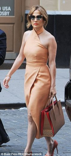 A tale of two outfits: Jennifer Lopez went from grungy to glam in New York City on Monday...