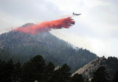 A tanker drops retardant near the top of Bear Peak while fighting the Flagstaff Fire in Boulder Wednesday morning. Andy Cross, The Denver Post
