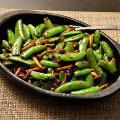 Stir-Fried Snap Peas and Mushrooms with Fish Sauce and Basil Recipe ( I bought these beech mushrooms at the Asian market so now I need to cook them!)