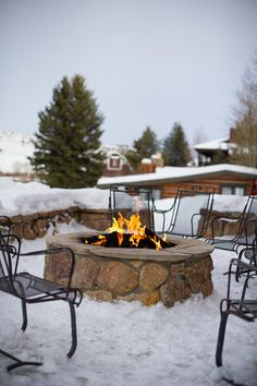 A fire pit blazing outside of a reception - AKA a chance for your guests to warm up! {@jameephoto}