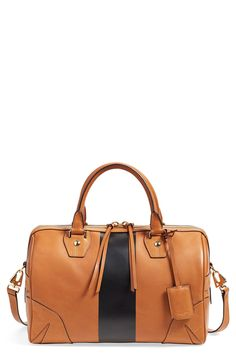 Loving this brown leather satchel with a bold stripe that has a roomy interior spacious enough to hold everything needed for the busy day, while a tethered card case keeps the necessities conveniently at hand.