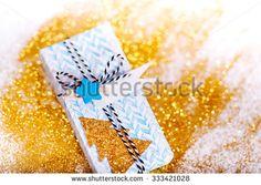 Christmas gift on shining background - stock photo