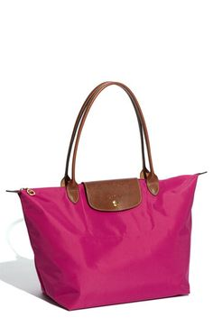 I love this bag ...I have it in orange. It goes with everything. Perfect everyday bag, travel bag, beach bag - it works for everything!