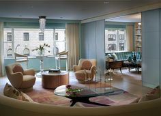 Clean lines for hiding drapery and door hardware.  Curved sofa and swivel chairs. Mid-Century Modern Living Room in New York, NY by Ike Kligerman Barkley.