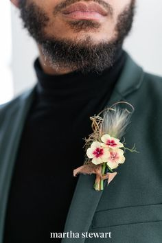 Petite ivory flowers with eye-catching berry-colored centers, textured foliage, and a neutral ribbon dress up the groom's sleek suit and classic turtleneck. #weddingideas #wedding #marthstewartwedding #weddingplanning #weddingchecklist Wedding Groom, Wedding Suits, Wedding Ceremony, Wedding Day, Unusual Wedding Venues, Wedding Vendors, Modern Groom, Groom Boutonniere, Bride Accessories